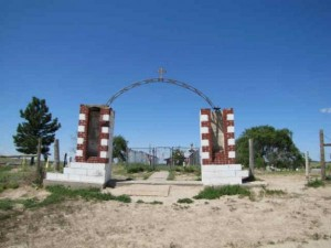 Monument erected at the site of the 1890 massacre of hundreds of Lakota men, women and children at Wounded Knee Creek by the U.S. 7th Cavalry. Photo courtesy of Indiancountrytodaymedia.com